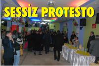 EMECAN'A TOPLANTI ORTASINDA SESSIZ PROTESTO